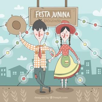 Casal bonito dos desenhos animados com roupa tradicional do junina do festa