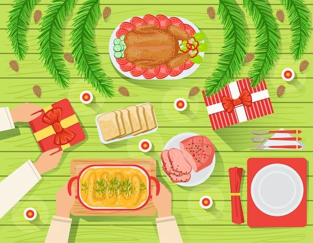 Casal com a tradicional mesa de natal vista de cima
