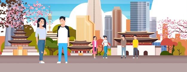 Casal coreano sobre a cidade de seul