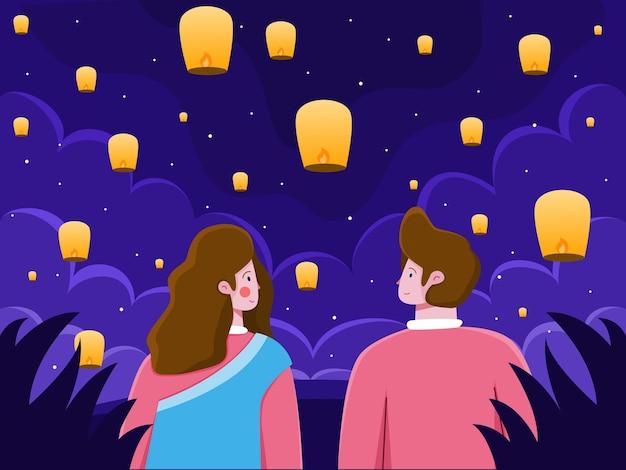 Casal curtindo uma bela noite com lanternas voadoras para celebrar o festival diwali da índia