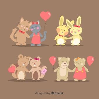 Casal de animais dos namorados com pacote de balões