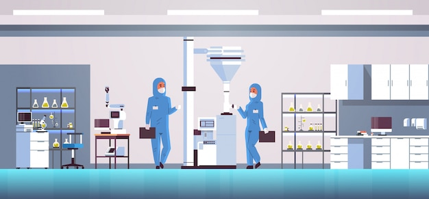 Casal de cientistas trabalhando com painel de controle, pressionando o botão iniciar na máquina especial