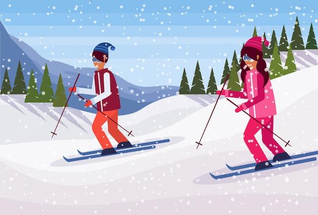 Casal de esqui nas montanhas