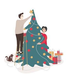 Casal de família decorando árvore de natal