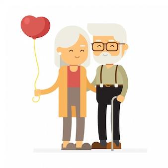 Casal de idosos com um balão, feliz dia dos namorados.