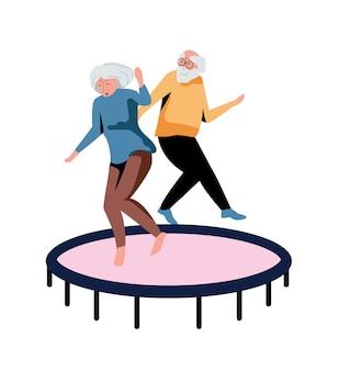 Casal de idosos felizes pulando juntos na cama elástica isolada