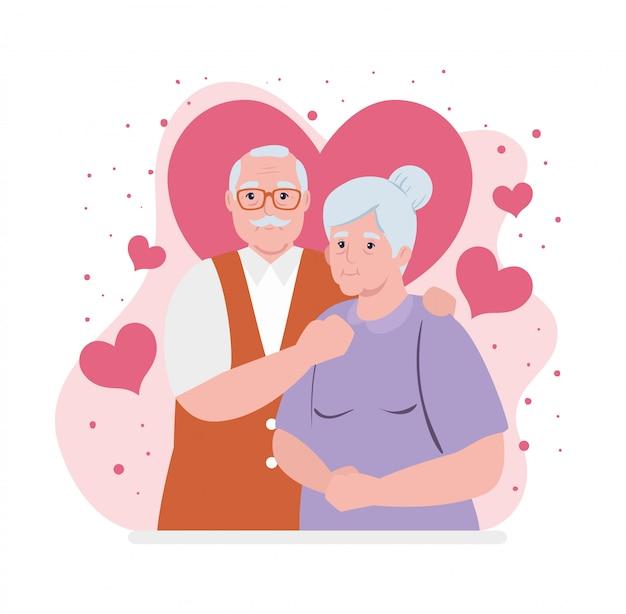 Casal de idosos sorrindo, velha e velho casal apaixonado, com decoração de corações