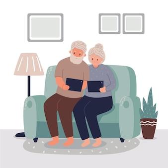 Casal de idosos usando mesas digitais