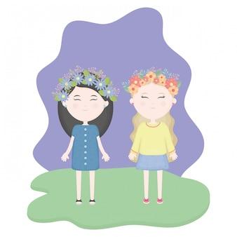 Casal de miúdas giras com coroa floral no cabelo no campo