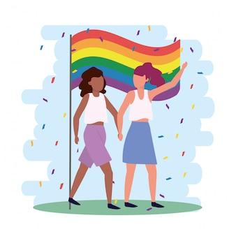Casal de mulheres junto com bandeira de arco-íris