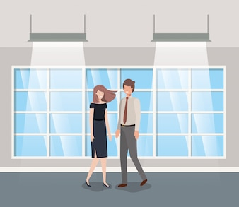 Casal de negócios no escritório do corredor