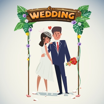 Casal de noivos com arco de casamento na selva
