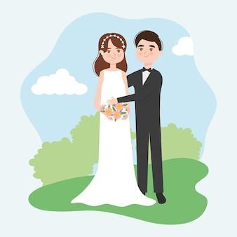 Casal de noivos em pé sobre a paisagem
