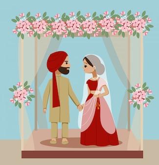 Casal de noivos indiano sob decoração mandaps