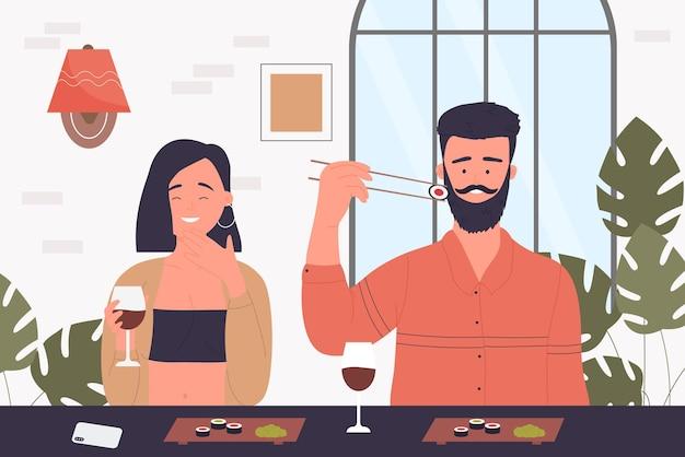 Casal de pessoas comem sushi no café japonês juntos, sentados à mesa no restaurante