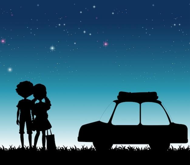 Casal de silhueta durante a noite