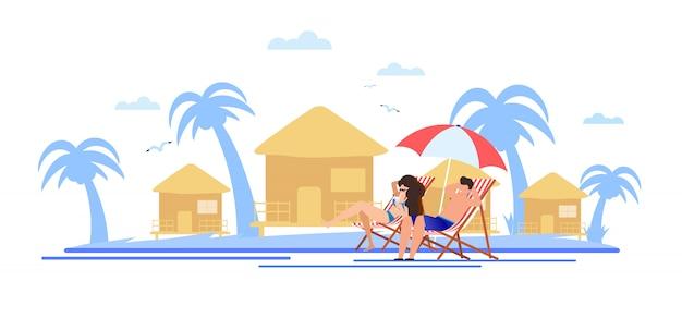 Casal dos desenhos animados, tendo descanso e banhos de sol na praia