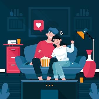 Casal em casa assistindo a um filme