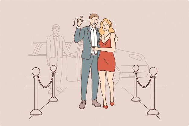 Casal famoso acenando para o conceito de câmera