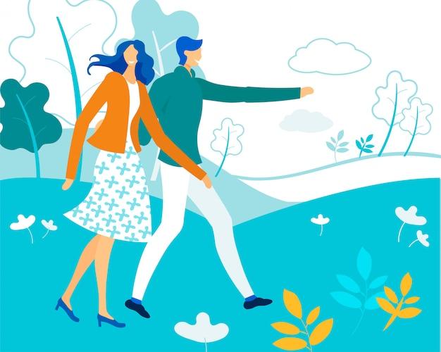 Casal feliz andando no belo parque ou floresta,
