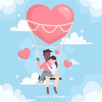 Casal feliz em um balão de ar quente