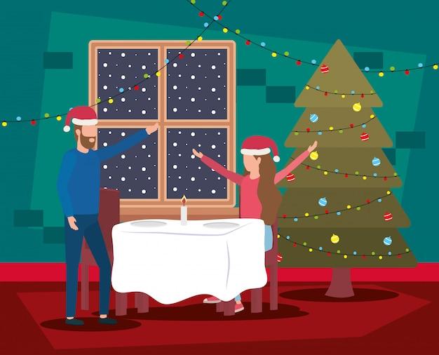 Casal feliz natal feliz comemorando com pinheiro