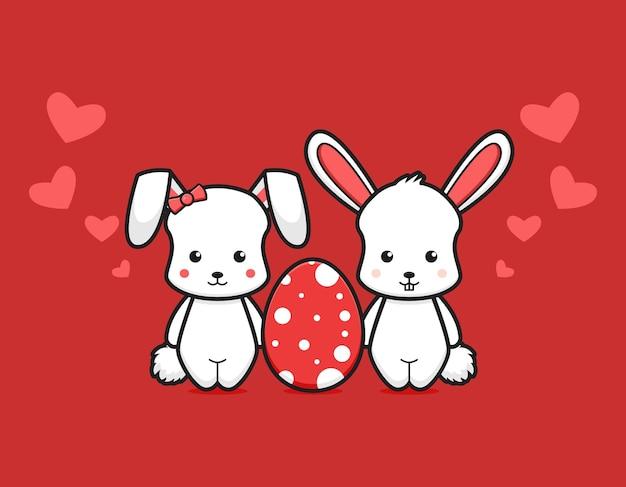 Casal fofo coelho com ovo adorável desenho vetorial ícone ilustração conceito de ícone de dia de páscoa