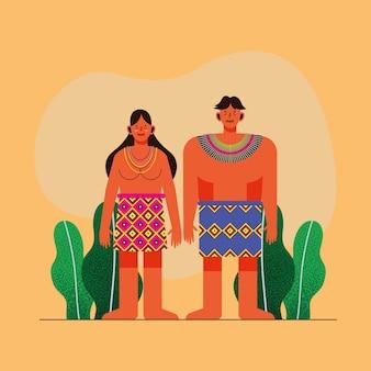 Casal indígena com saia tradicional em fundo laranja