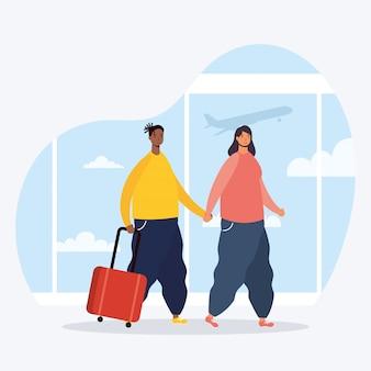 Casal interracial viajantes com malas