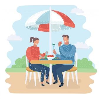 Casal jantando no café de rua.