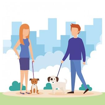 Casal jovem com cães no parque