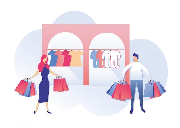 Casal jovem com sacos de compras na loja para crianças