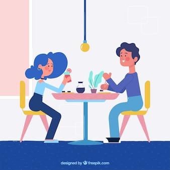 Casal jovem jantando no restaurante