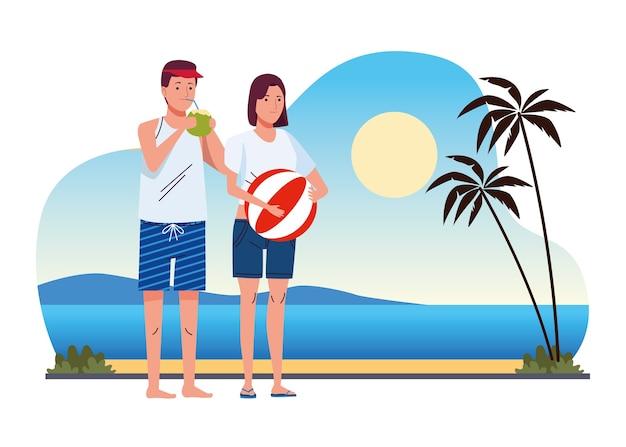 Casal jovem vestindo maiôs com coquetel de coco e balão na cena da praia