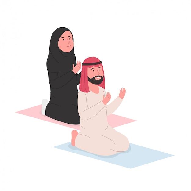Casal muçulmano árabe rezando juntos