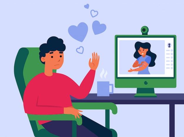 Casal namorando on-line por videochamada