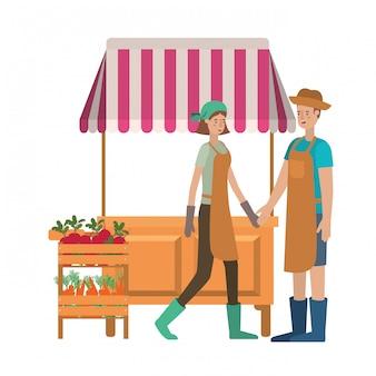 Casal no quiosque de loja com caráter de avatar de legumes