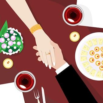 Casal no restaurante de mãos dadas