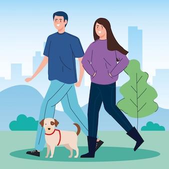Casal passeando com seu cachorro no parque
