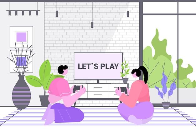Casal se divertindo jogando videogame homem mulher usando gamepads sem fio.