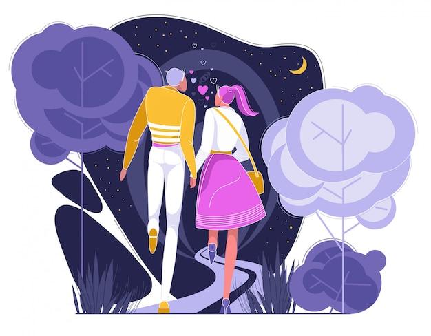 Casal tendo encontro romântico no parque à noite