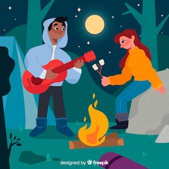 Casal tocando violão em uma noite de lua cheia