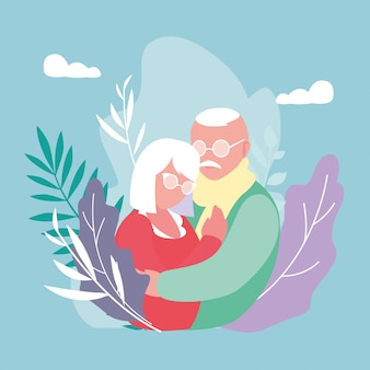 Casal velho bonito abraçado com decoração de folhas