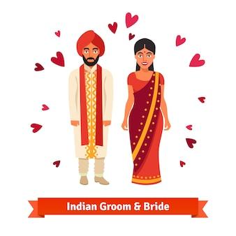 Casamento indiano, noiva, noivo em trajes nacionais