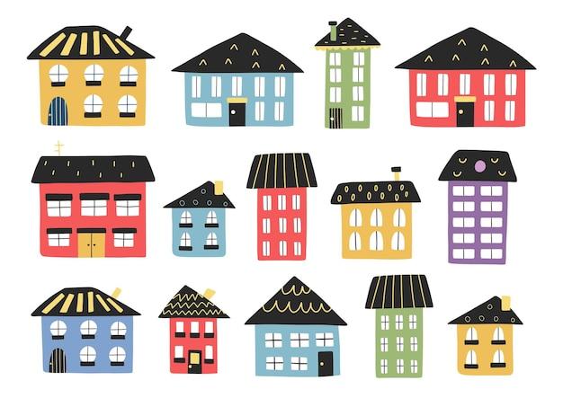 Casas de desenho animado em conjunto com a coleção de pequenos prédios da cidade flat