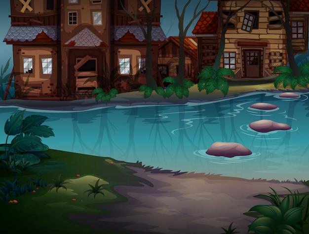 Casas em mau estado ao longo do rio