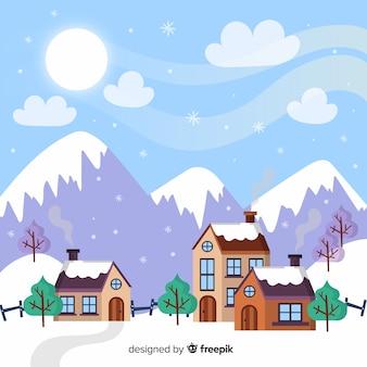 Casas pela paisagem de inverno da montanha
