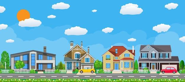 Casas privadas suburbanas com carro, árvores, estrada