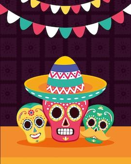 Caveiras mexicanas com chapéu e guirlandas