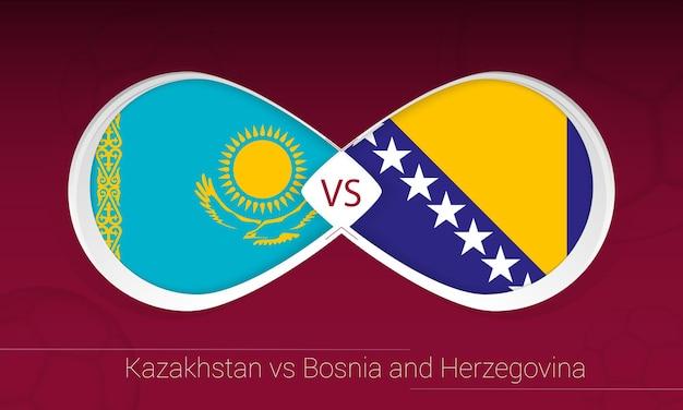 Cazaquistão vs bósnia e herzegovina em competição de futebol, grupo d. versus ícone no fundo do futebol.